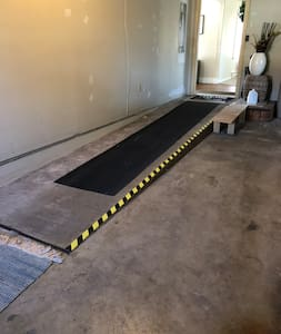 Ramp built into garage allowing you entrance directly from it.