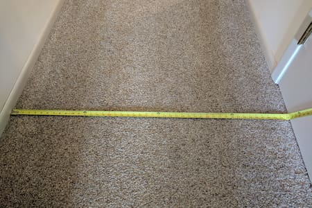 Exact measurement of hallway that leads to the upstairs living room, and the bedrooms and bathroom.