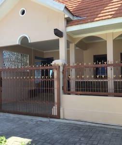 Main entrance and garage