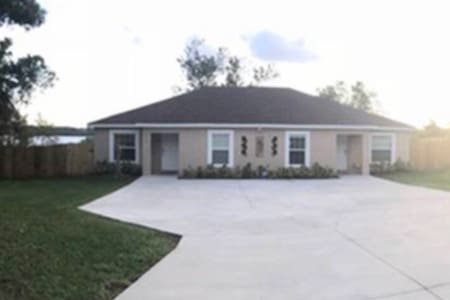 Plenty of parking space in front of each property. Lake Mariam Vacation Home is part of a duplex (built in 2016) for Guest. Our guest has a lot of privacy, with their own patio and privacy fence around the 2.6 area lot.