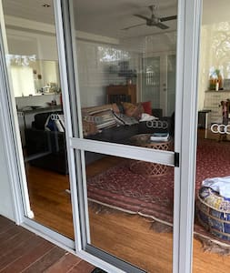 Sliding door enables access to the apartment. Lock box to the left of the door.
