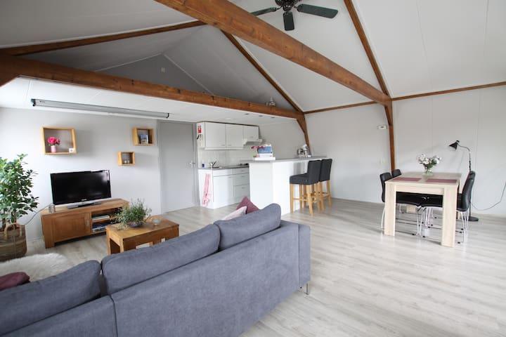 Ruim & licht appartement in authentieke koolschuur