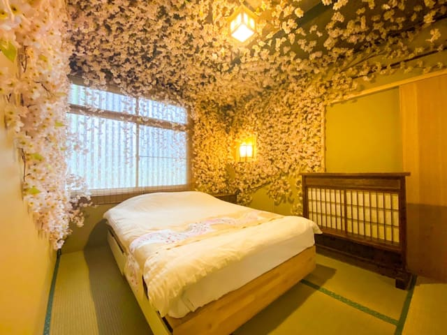 The bedroom was decorated with cherry blossom.