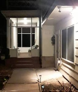The porch light stays on 24/7, and the motion-sensitive light in the top right-hand corner of the picture comes on automatically as you approach the Lobby entrance on the porch.  We also have solar yard lights along the entrance path.