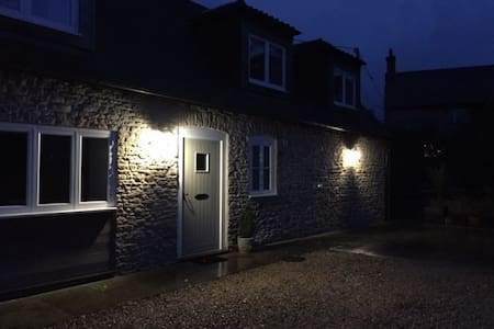 The front door and car park area is well lit at night by two wall lights (this photo was taken after dark!). There are similar lights for the patio too.