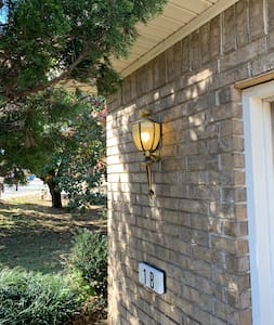 There are two lights like this when you pull into the driveway to give you plenty of light and when you round the corner on the sidewalk there is a light on at the front door so that you can see