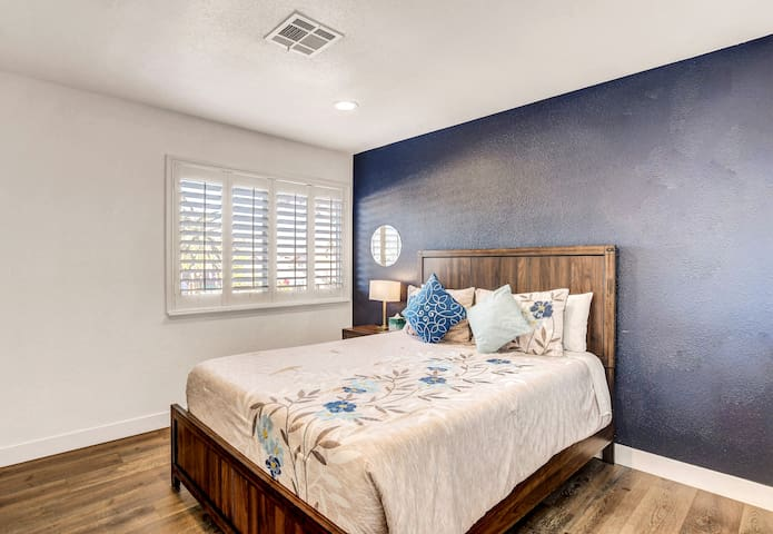 First guest bedroom with comfortable queen size bed