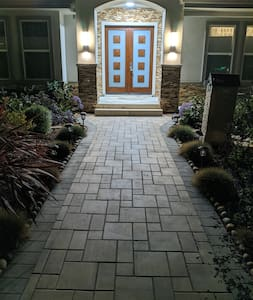 Well-lit path to entrance.