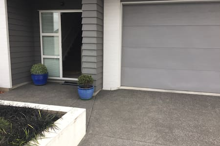 Entrance from driveway through front door consists only of a 2-3 inch step up into the home