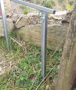 There are some steps from the driveway to the front path with a hand rail for assistance if needed.