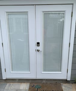 "French doors with small 6"" stoop at threshold"