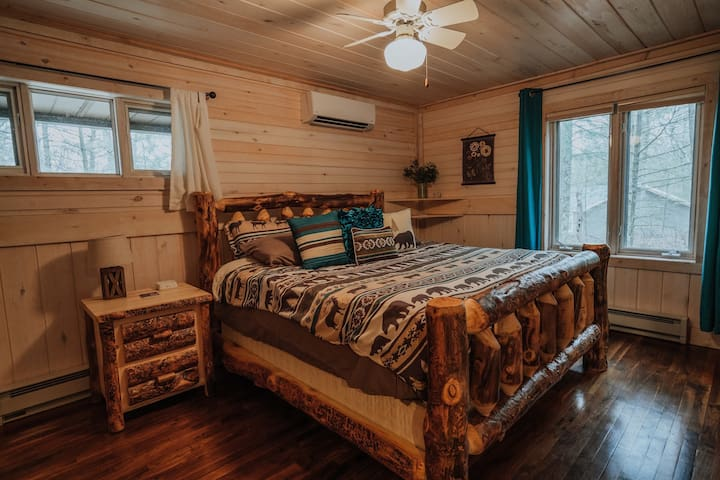 Master bedroom-  Enjoy the Amish made aspen log King bed, with plenty of space. Fan and AC in room.