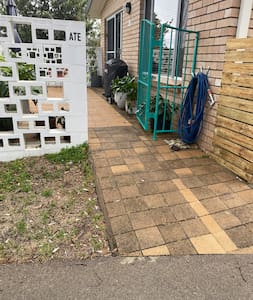 Front patio and pathway from driveway to sliding front door