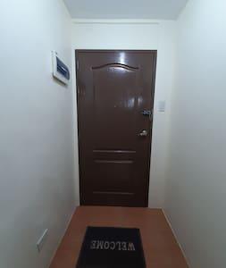 The entrance door of the condo unit.
