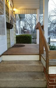 3 low tred stairs and a heavy duty railing to use. Lights on both sides of the door as well as a street light across the street.