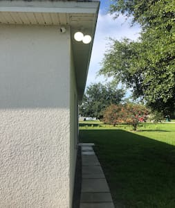 Walkway is well lite with motion activated security lights.