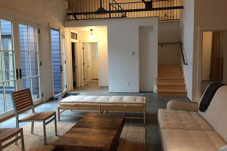 There is just one small step to enter the building. Once inside the entire unit (other than the 2nd Story Sleeping Loft) is on one level. All polished concrete. No transitions between rooms. Front entrance on left.