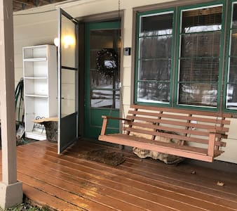 There is a 2 inch rise from the ground level where your car will be parked onto the wooden landing. The door threshold has a 1/2 inch weather protector rise as you go through the entry.