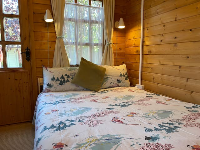 Lovely chalet double bed complete with reading lights