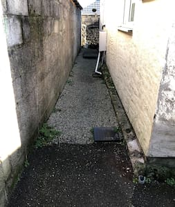 Private pathway to annex entrance one low step