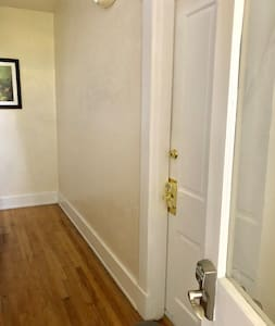 Front entrance before arriving to your apartment. This hallway has bright lights during the evening hours