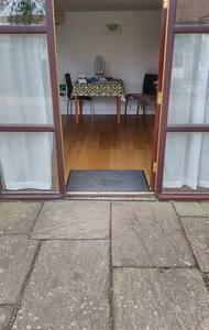 """Front Door, 1.5"""" step from paved approach, door width is 34"""""""