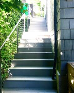 Stairs leading down to the private garden patio. Water feature & front door.