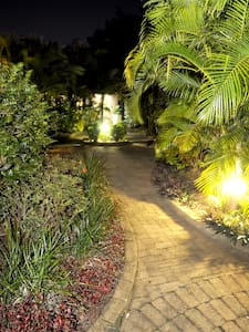 There is lighting beside pathway for accessibility at night.