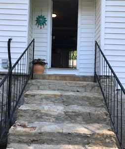 Entrance with stairs and lit entry way