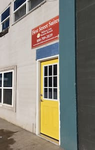 Yellow door to the entrance landing