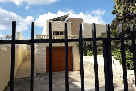The side ramp has been purposely built to allow wheel chair/moto mobility entrance into the villa from the back entrance.  No stairs involved.