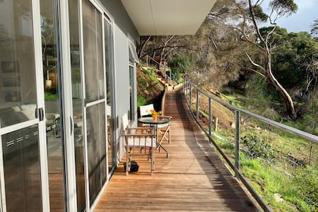 Easy access to your self contained apartment no 2 by ramp and decking from top car park.  There is also stair access.  Sliding door with key code access.