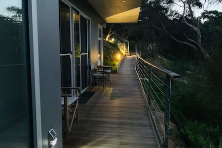 Easy well lit night time access via a ramp that winds around from the top car park to the entrance of apartment 2.  There is also step access pictured on top right. Great viewing deck to see wildlife and sunrise.