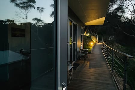 Arriving after dark, drive up to the top car park then take the long ramp just past the steps to Apartment 2 entrance.  Its well lit all the way.  Great for wheeling suitcases too.