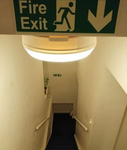 The entrance has well lit stairway and corridor. Clearly posted fire exit and fire alarm.