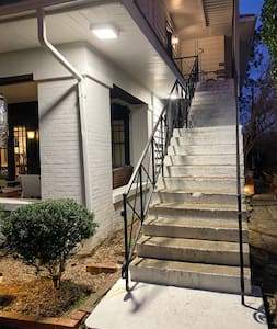 No matter what time you arrive, you'll be able to access your apartment easily. Dusk-to-dawn lights illuminate the exterior of the house and the stairs leading up the the apartment.