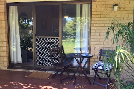 This is the patio door that faces the lawn area. It can be accessed from the garage by a wide concrete path along the outside wall of the unit.