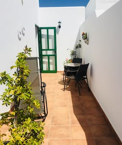 The complex is wheel chair friendly, well lit and fairly flat with some gentle slopes. The access and the apartment is wheel chair friendly. You would need some walking ability to use the bathroom