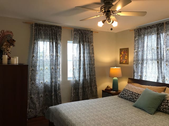 Get comfy in the king size bed and sleep peacefully with a gentle cross breeze or flip on the AC in Bedroom 1.  Plenty of storage for your things - closet, tall dresser, and two nightstands with drawers.