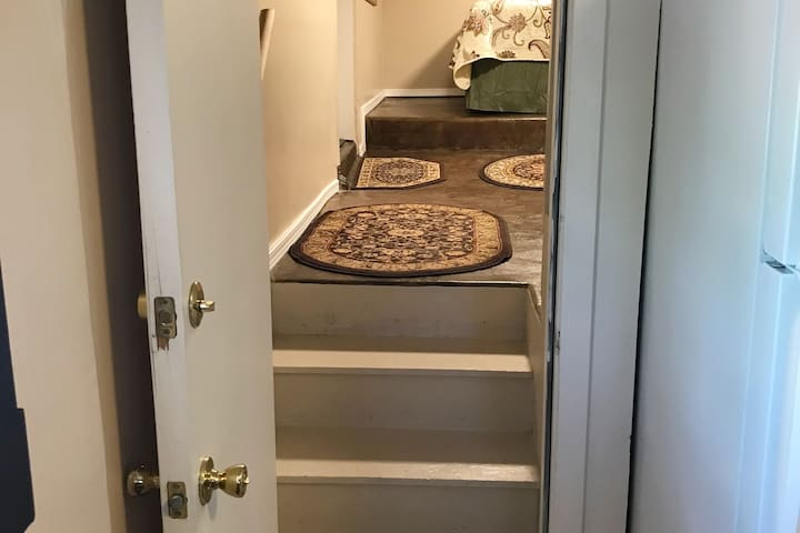 Entrance to the bonus bedroom is accessed from the kitchen