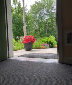 """The main wide entrance door with the completely flat entry, no stairs or steps at all. As a matter of fact, this whole house is completely wheelchair accessible, following universal design requirements. 35"""" wide doors, wide walkways, lower windows.."""