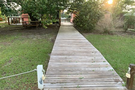 Wide wooden walkway from parking to entrance