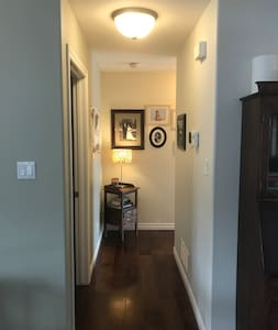 Main hallway with 90 degree turn servicing three upstairs bedrooms and bathroom.
