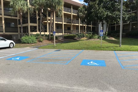 Disabled parking by ramp to elevator and luggage carts! More disabled parking by Beach Boardwalk and pool!