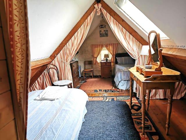 Best suited to children, the attic bedroom has 2 single beds and en-suite toilet