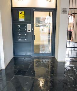 Step free entrance. Door is 91cm wide. Taken from outside. Floor is wet as cleaner had just washed it.
