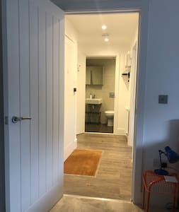 Picture taken in bedroom showing hallway, front door to left, lounge to right and bathroom at end. Hallway is 115cm wide and door frames are 80+ cm wide