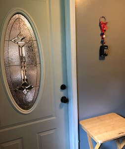 mudroom / foyer is on same level with driveway, family room (living room 2), bathroom, 2 twin XL electric profiling adjustable beds, dining room, and master bedroom.