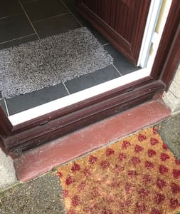 This is the only small half step into the property where everything else is in the level . getting around the inside of the house and both gardens are all level with no steps or stairs . Perfect for people with limited mobility and pensioners