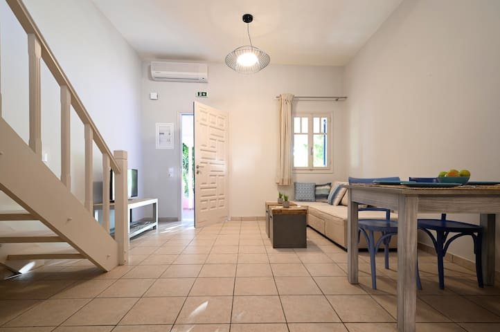 Kefalonia apartments: spacous 1 bedroom apartments in Spartia -  ground floor apartments have a living room with open-plan kitchen, bathroom and loft-type bedroom.   .